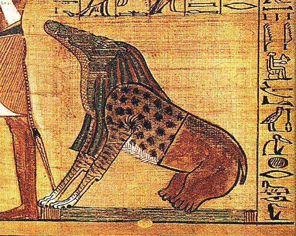 Ammit the Devourer pictured sitting awkwardly at the feet of an unknown god situated slightly out-of-shot